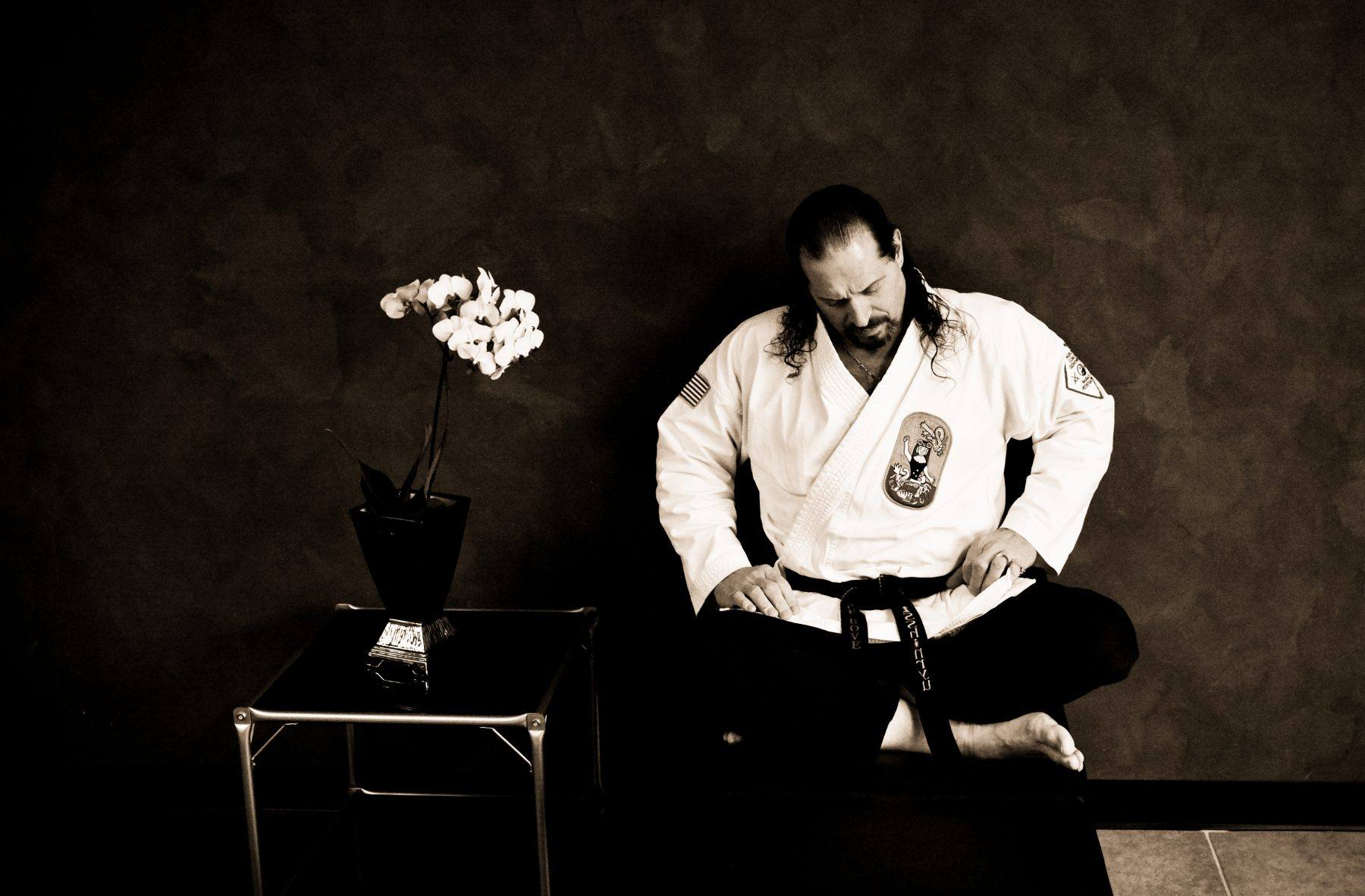 Martial arts master rests in his dojo.
